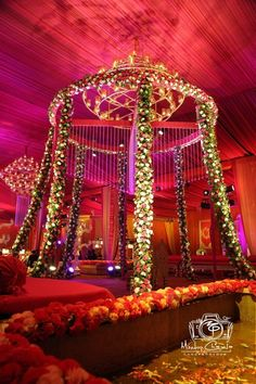 red themed decor, floral mandap, candle lights chandelier