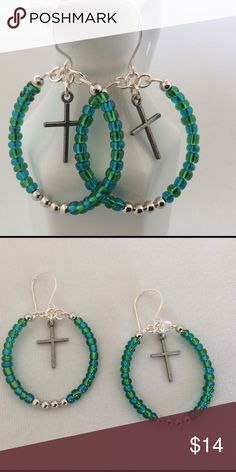 """Blue and Green Cross Hoop Earrings These beautiful hoop earrings feature a cross in the center of the hoop. They are made with silver wire, blue and green glass beads, and silver beads. They are 1 3/4"""" long. Becky Barnes Designs Jewelry Earrings"""