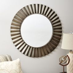 Brighten your interior décor with the shimmering display of the Household Essentials Sunburst Round Wall Mirror. Boasting a bronze frame with intricate details that emulate the rays of the sun, this unique mirror adds a striking accent to your wall. Sunburst Mirror, Round Wall Mirror, Wall Mounted Mirror, Round Mirrors, Wall Mirrors, Bathroom Mirrors, Brighten Dark Room, Unique Mirrors, Home Decor Outlet