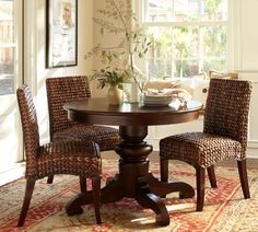 I'm thinking a large round dining table would be beautiful and make better use of our space.
