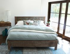 (https://www.zinhome.com/hampton-rustic-teak-wood-king-bed-frame/)