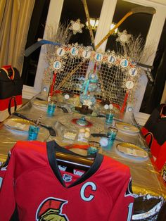 Hockey Birthday Party!! Love the chairs covered with jerseys! hockey_winter_dessert_table_birthday_party_233049