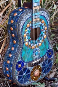 @ Melissa Frye, yard art for your hubby???  Blue mosaic covered guitar - got to love this!