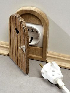 Clever and cute way to disguise outlets!