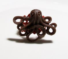 Chocolate Brown Octopus on a Cayenne Red Metal Filigree Adjustable Ring