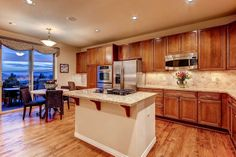 Nice open kitchen with hardwood floors, eat-in area, and cooktop in the island