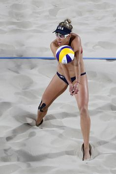 April Ross of United States bumps the ball during the Women's Beach Volleyball preliminary round Pool C match against Fan Wang and Yuan Yue of China. Volleyball Articles, Volleyball Gear, Coaching Volleyball, Women Volleyball, Volleyball Players, Beach Volleyball, Volleyball Funny, Usa Olympics, Rio Olympics 2016