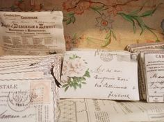 Purses printed with vintage postcards.