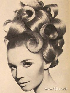 1967 large curls hairstyle        Hairstyle by: Maurice  Salon: Maurice and John French  Location: London
