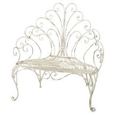 """Featuring a scrolling back and cabriole front legs, this eye-catching metal garden bench is highlighted by a distressed cream finish for warmly weathered appeal.   Product: Garden benchConstruction Material: MetalColor: Distressed creamFeatures: Scrolling detailsCabriole front legsDimensions: 45"""" H x 45"""" W x 21.5"""" D"""