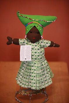 The Herero Doll ~  The Herero are traditionally cattle-herding pastoralists. The main group of Herero in Namibia was heavily influenced by Western culture during the colonial period, creating a mixture of the European and Herero cultures. The Herero women of Namibia traditionally wear Victorian-inspired headdresses and heavy skirts with several petticoats. Their horn-shaped hat, made from rolled cloth, is said to represent the horns of a cow.