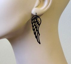 These beautiful earrings are inspired by angels .     They are made from black acrylic and hang on NICKEL FREE Gunmetal plated over brass earwires.     Total Length is approx 2.3 inches (58.5mm) from the top of the ear wire.     These earrings are lightweight yet substantial.     All of my jewelry comes with a gift box.  Price: $27