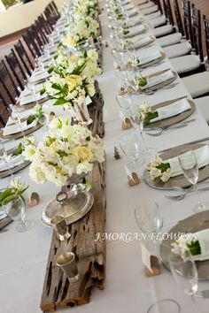 I love the plank of wood down the middle of the table and the white flowers everywhere