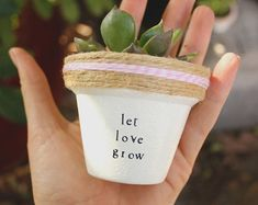 """This listing is for one 2 hand decorated terracotta pot with the phrase Youre A REal Prick!!""""  Hooray puns! These pots are a perfect addition to your home, office, friends house, mothers kitchen or anywhere you can put a pun on it! Brighten your day and windowsill with these hand decorated pots made out of a home workshop in East Los Angeles.  » Pot does not include plant » The height and diameter of the pot are 2 inches » All pots are sealed with an earth safe finish for safe growth of all…"""