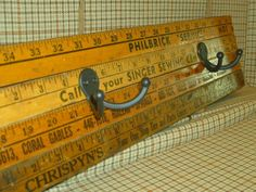 """great idea...look for old yard sticks in thrift and antique shops! You can also get a board cut 1/2"""" wide and 4' long, then stain or paint wood and add any kind of silver or gold hooks you like best. Hang on wall for coats, book bags, etc."""