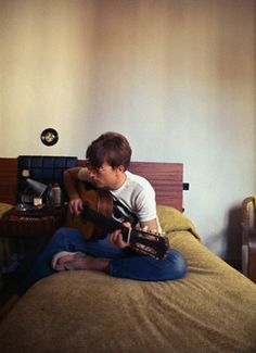 John playing his Gibson in his hotel room (October 1966)