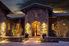 stone front entrances for homes | Northwest Tuscan Style home with a stone and custom iron works entry ...