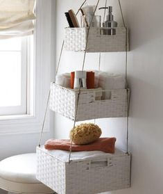 Hanging nesting baskets for the bathroom. Such a great idea. Especially for houses with little storage.