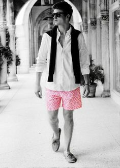 """Oxford, sweater around the shoulders, 5"""" inseam on a pair of pink trunks, and a pair of A/Os. This guy is walking hotness."""