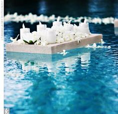 Pool Wedding Decoration Ideas 11 pool weeding decoration Floating Tea Lights And White Orchids Filled The Infinity Pool Which Was In The Side Floating Pool Decorationsbackyard Weddingsoutdoor