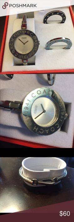 Coach interchangeable face watch, bangle Coach watch with beautiful silver arm band. Black and blue interchangeable faces that have never been used. Has some scratches on the face and needs a new battery. I tried to get the scratches on picture number 2 but they weren't cooperating. Comes in box. Coach Accessories Watches