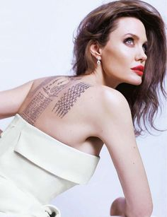Actress Angelina Jolie shows off her back tattoo for Guerlain. Photo: Mathieu Cesar