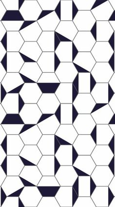 Berlin is a Black and White Geometric Vinyl Flooring design that features a hexagonal tile effect, made up of clean white shapes with graphic dark grey outlines and deep navy blue accents that cut through at abstract angles to creating a modern, edgy look. #vinyl #flooring #vinylflooring #vinyltiles #floortiles #Ihavethisthingwithfloors #tiles #design #interior #homedecor