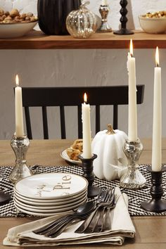 Let metallic accessories be the silver lining in a black and white tablescape.