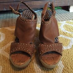 """Jessica Simpson sz 7.5 wedges Good used condition.  Probably wore 3 or 4 times. Camel color with silver studs. Heel is 5"""" and toe is a little under 2"""" Jessica Simpson Shoes Wedges"""