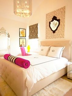 I love the wall art, monogrammed pillows, upholstered headboard and the colors!