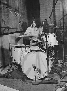 John Bonham. He made so much sound from so little. 4-piece is all you really need.
