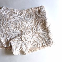 """SHORTS SALE! Vivian Diamond Lace High Waist Shorts Amazing high waist lace shorts. New without tag. Discontinued online and in store. Lined inside. Zip and hook and eye closure on one side, pocket on other. Elastic Waist. Perfect for just looking hot whenever you want. Also perfect for a bridal gift cause the groom will be wanting to see the bride in these, as will pretty much everyone else. Marked XS, but will also fit a Small because of elastic waist.   Length: 11.5"""" Inseam: 2.8"""" Leg…"""