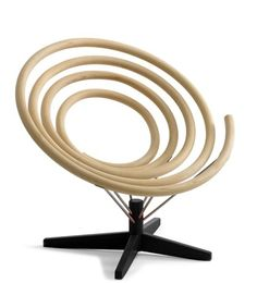 Spiral Chair.  Designed by Fredrik Mattson, produced by Danish company PP Möbler.  Compressed wood, stainless steel.  2008