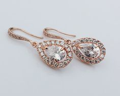 JESS Collection Rose Gold CZ Bridal Earrings Gorgeous Earrings are made with sparkling cubic zirconia crystals in rose gold plated settings Earrings measure about 1 long Available in yellow gold, white gold, and rose gold plated finish Stylish Jewelry, Jewelry Accessories, Fashion Jewelry, Bridal Accessories, Jewelry Box, Bridesmaid Earrings, Wedding Earrings, Gold Drop Earrings, Crystal Earrings