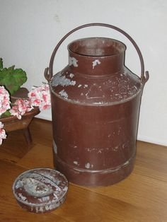 Old Milk Can Galvanized Chippy Brown Paint Country Farmhouse Large 15 QT Shabby Cottage Garden Decor. $38.00, via Etsy.