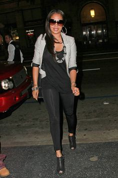 bdc4f13f906 A pair of shiny black leggings infused some sexiness into La La Anthony s  smart dinner outfit