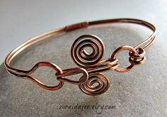Nice use of Egyptian coil. No tute here but blog has slideshow with many nice bracelet ideas. #Wire #Jewelry #Tutorials