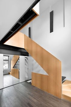 Refurbished Montreal residence featuring a ribbon-like staircase.