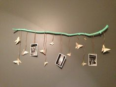 Origami butterflies and twine make for a cute and natural decoration on a gray wall!