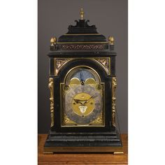 A VERY LARGE DUTCH EBONY AND EBONIZED GILT BRASS MOUNTED MUSICAL TABLE CLOCK FOR TWELVE MELODIES THIRD QUARTER 18TH CENTURY