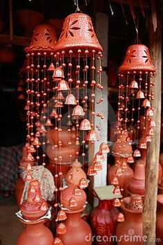 Elegant pottery wind chimes in the shape of bells on sale at a ...300 x http://45066.9KBwww.dreamstime.com