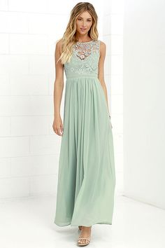 A lovely crocheted lace yoke forms a sweetheart silhouette atop a lightly padded bodice with darted detail. Dreamy chiffon takes over at the banded waist to fall into a showstopping maxi skirt. Three hook clasps join above the open back. Hidden back zipper with clasp.
