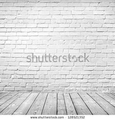 room interior vintage with white brick wall and wood floor background by Artur Marfin, via Shutterstock