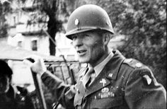 Captain Winters of 506th PIR, 101st Airborne Division, is promoted to the rank of major at Haguenau, France. March 8, 1945