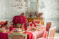 """Deviate from a singular tone and you'll set a lush scene  that's anything but flat. """"I often take one color and delve into it in different ways. A super-saturated color pops so vibrantly,"""" says Heather Christos of her chinoiserie-inspired tablescape. """"When you use an everyday item in mass quantities — like the gobs of red roses — it translates into luxury."""""""