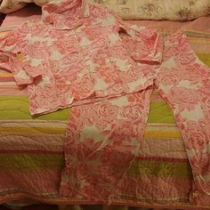 Lilly Pulitzer rose pajamas or loungewear Lilly Pulitzer pjs or loungewear, white with large pink rose print, Size small, 60% cotton 40% modal, super soft and so cute!  Great condition with no flaws.    Price firm unless bundled.  Thanks! Lilly Pulitzer Intimates & Sleepwear Pajamas