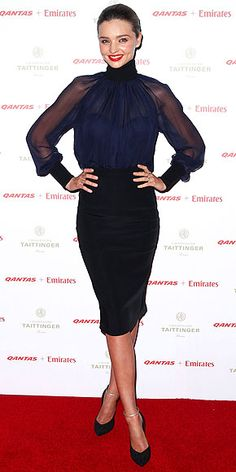 MIRANDA KERR Who needs angel wings when you have such cool sheer sleeves. Miranda wears the translucent navy top with a black pencil skirt, Casadei pumps and a killer red lip to a Qantas gala in Sydney.