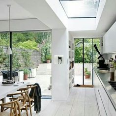 Open plan kitchen extension on Victorian terrace. Sky lights and bifold doors onto same level outdoor flooring for a smooth inside/outside transition