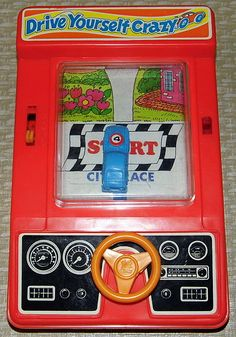 """Tomy """"Drive Yourself Crazy"""" handheld game"""