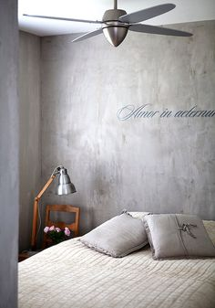 Concrete wall with writing  polished lime or clay plaster